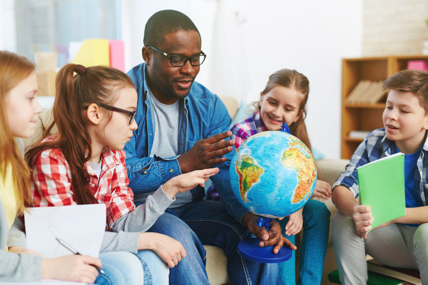 teacher and students with globe