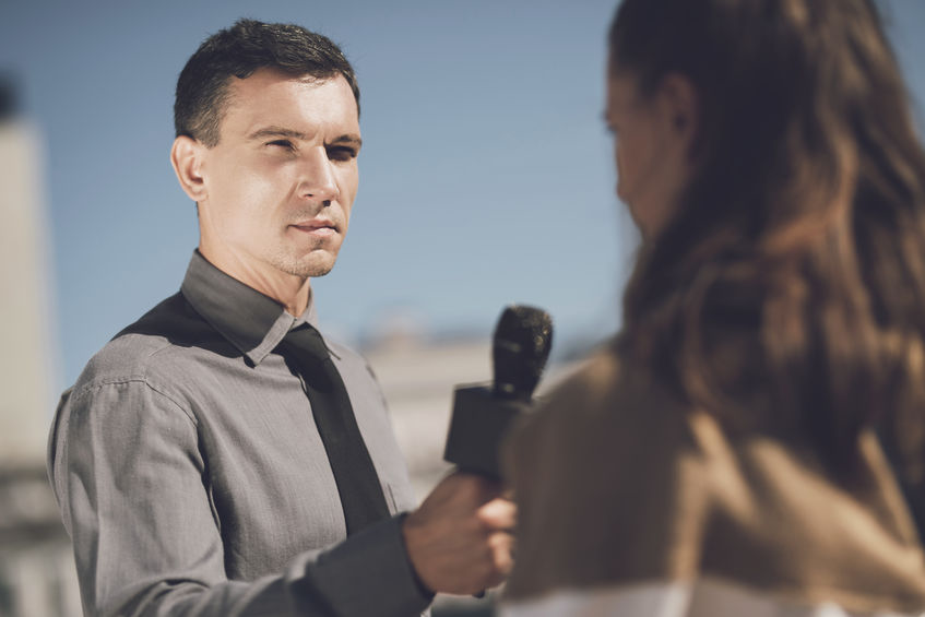 reporter interviewing someone